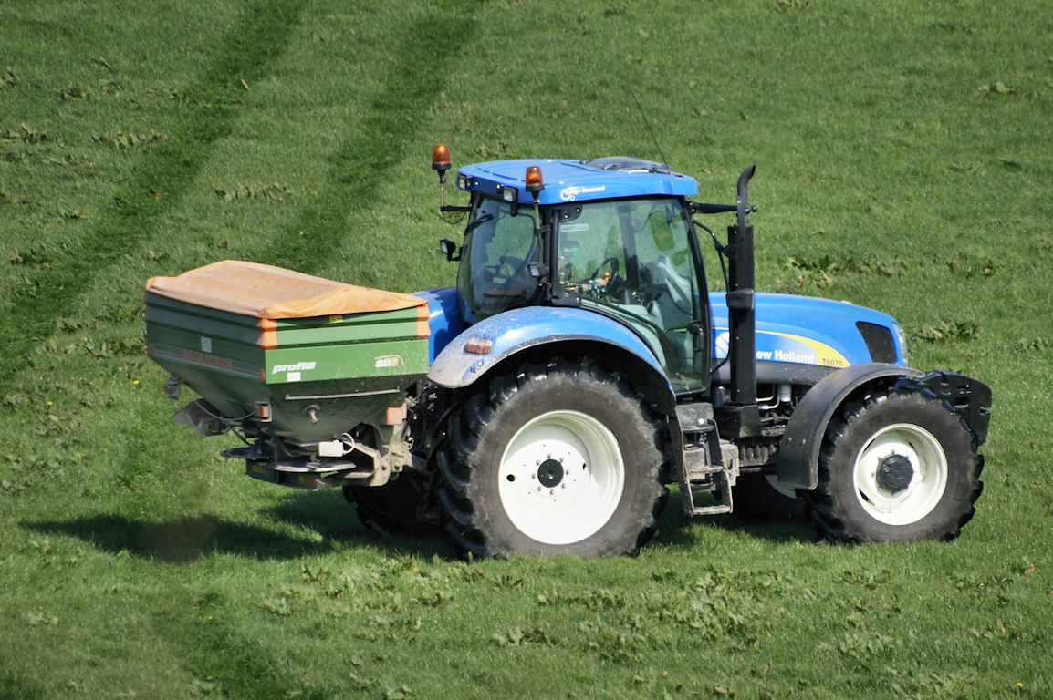 Tractor spreading fertilizer new holland